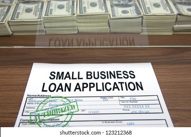 Approved small business loan application and dollar bills