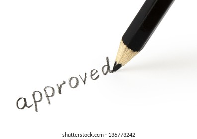 approved written in pencil on a sheet of paper