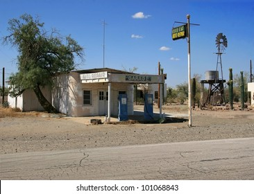 Approx. 30 photographs were merged to create a great looking vintage service station,water tower,blue colored gas pumps and white adobe style buildings./  Vintage Auto Repair Shop / Very cool !