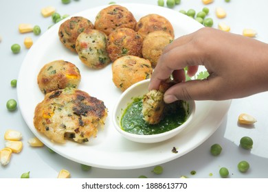 Appum or Appe, Appam or Mixed dal or Rava Appe served with green  chutney. A Ball shape popular south Indian breakfast dish, Selective focus