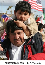 Apr 10, 2006; San Jose, CA, USA; A man and his son join thousands of people marching in a pro-immigration rally to protest the proposed new immigration legislation HR 4437 in San Jose, California.
