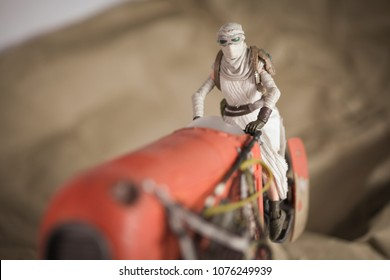 APR 23 2018: Scene from Star Wars The Force Awakens; Rey on her speeder on the planet Jakku - Hasbro Black Series action figures