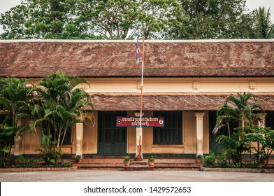 APR 4, 2019 Luang Prabang, Laos - Yellow old classic French Colonial building of elementary school with green door and windows in Luang Prabang - Laos