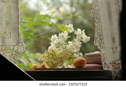 Apricot, cherry and Jasmine flowers on the window