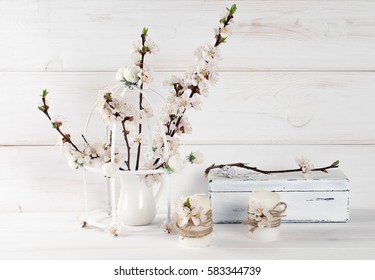 Apricot flowers in vase, candle and old vintage casket with rose in Shabby Chic style. Spring interior.