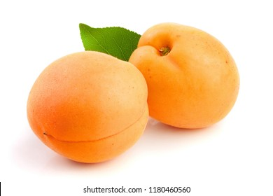 Apricot fruit with leaves isolated on white background macro