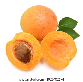 Apricot fruit whole and half with leaf isolated on white background. Flat lay, top view