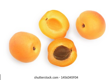 Apricot fruits isolated on white background. Top view. Flat lay pattern