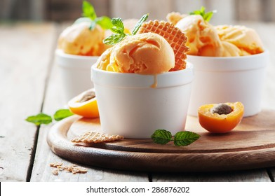 Apricot ice-cream with mint, selective focus