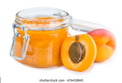 Apricot Jam isolated on white background (selective focus; close-up shot)