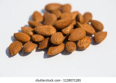Apricot kernels on white background
