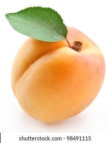 Apricot with apricot leaf on a white background.