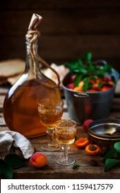 Apricot liqueur in the glasses .style vintage. selective focus