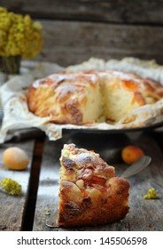 apricot  pie with ripe apricot fruits on the rustic backgrownd