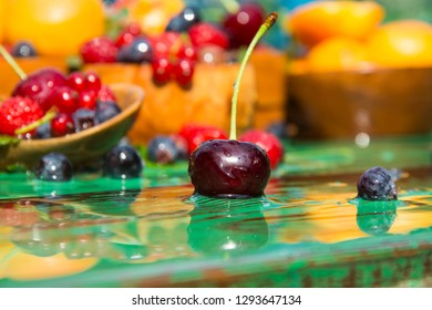 Apricot, raspberry, currant, strawberry, blueberry, cherry. Fresh fruits and berries on a wooden table.