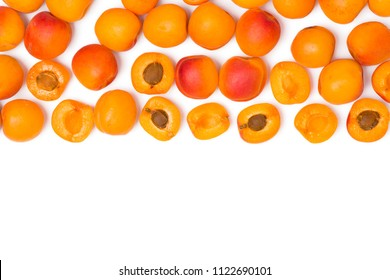 Apricots and cut apricots on a blank (white) background,  arranged on top side, with copy space. Top view.