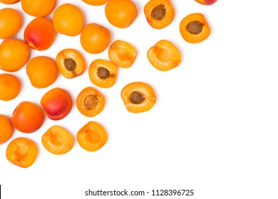 Apricots and cut apricots on a blank (white) background,  arranged on top left corner, with copy space. Top view.