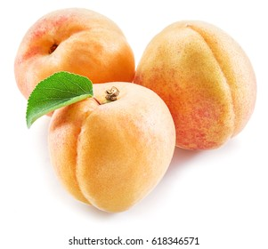 Apricots fruit with leaves on a white background.