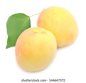 Apricots with leaf on a white background.