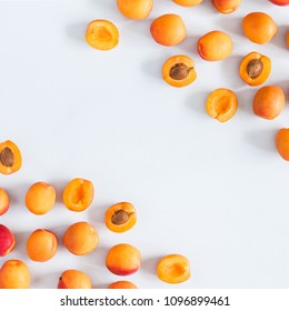 Apricots on pastel blue background. Flat lay, top view, copy space, square