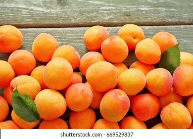 Apricots on wooden