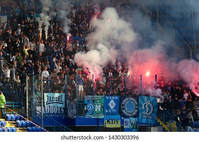 APRIL 07, 2019 - KHARKIV, UKRAINE: FC Dynamo Kyiv fans and ultras supporting their team on stands burning fires and pyro. Ukrainian Cup. Shakhtar Donetsk - Dynamo Kyiv
