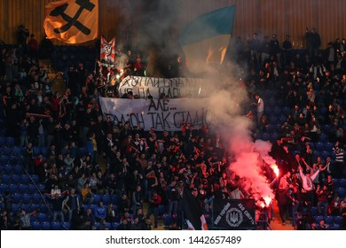 APRIL 07, 2019 - KHARKIV, UKRAINE: Pyro and fire show on the stands by FC Shakhtar Donetsk fans and ultras. Ukrainian Cup. Shakhtar Donetsk - Dynamo Kyiv