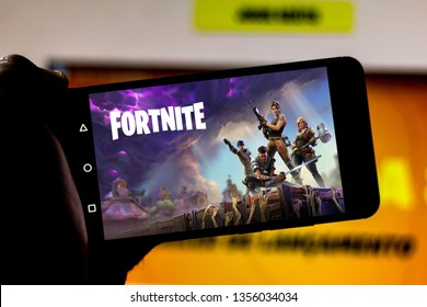 April 1, 2019, Brazil. Play Fortnite on the screen of the mobile device. Fortnite is an online multiplayer online game developed by Epic Games.