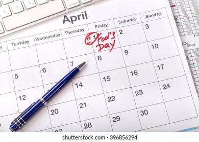 April 1 in the business calendar. Written on the calendar April Fools' Day. April fool day on first day of april month. Business concept - calendar, table, pen, keyboard, work.
