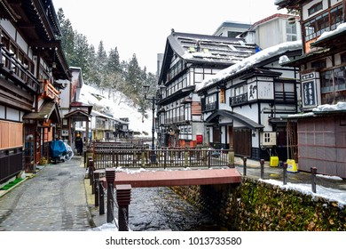 April 10, 2016. The ryokan staffs were clearing the snow on the roof of ryokan in Ginzan onsen village, Yamagata prefecture, Japan