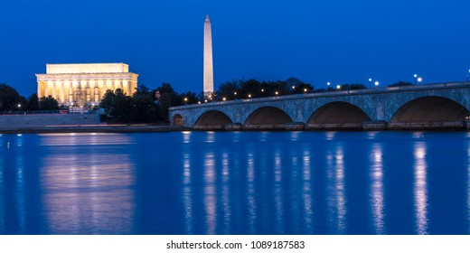 APRIL 10, 2018 - WASHINGTON D.C. - Memorial Bridge at dusk spans Potomac River and features Lincoln Memorial and Washington Monument