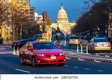 APRIL 11, 2018 WASHINGTON D.C. - Red car down Pennsylvania Ave to US Capitol going towards US Capitol in Washington DC. during rush hour PM
