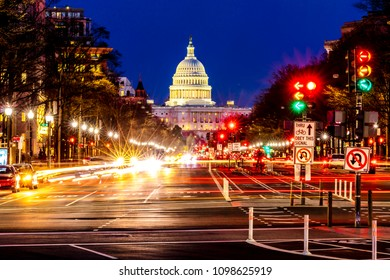 APRIL 11, 2018 WASHINGTON D.C. - Pennsylvania Ave to US Capitol with Streaked lights going towards US Capitol in Washington DC. during rush hour PM