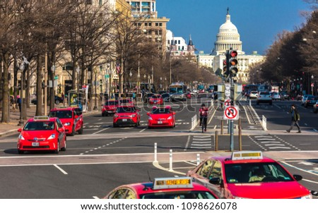 APRIL 11, 2018 WASHINGTON D.C. - Pennsylvania Ave to US Capitol going towards US Capitol in Washington DC. during rush hour PM features Red Taxis