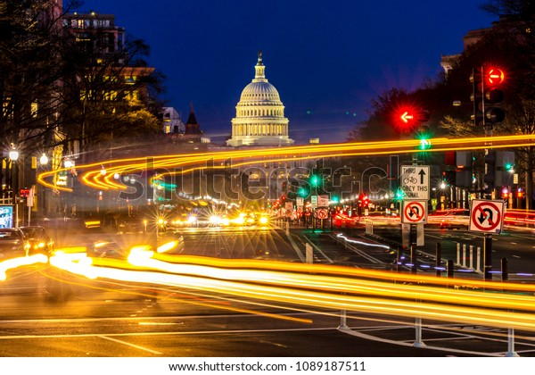APRIL 11, 2018 WASHINGTON D.C. - Pennsylvania Ave to US Capitol withStreaked lights going towards US Capitol in Washington DC. during rush hour PM