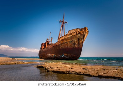 April 12 2017-Rusty and abandoned shipwreck stands on a coastline near Gythio in Lakonia. Peloponnese Greece
