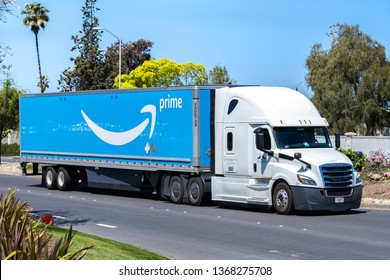 April 12, 2019 Newark / CA / USA - Amazon truck driving on a street in East San Francisco bay area; the large Prime logo printed on the side