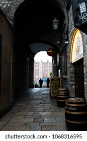 April 12th, 2018, Dublin, Ireland - The Merchants Arch in Temple Bar district, located on the southbank of the River Liffey, spread over cobbled pedestrian lanes with crowded pubs and restaurants.