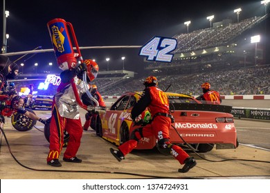 April 13, 2019 - Richmond, Virginia, USA: Kyle Larson (42)  and crew make a pit stop for the Toyota Owners 400 at Richmond Raceway in Richmond, Virginia.
