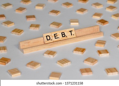 "April 14, 2019: Vancouver, B.C. Canada (Editorial) - Scrabble Word Game wood tiles spelling ""Debt"" - Image"