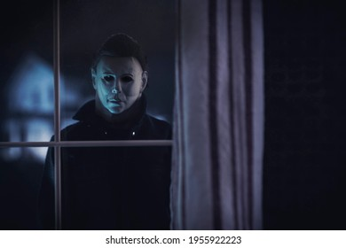 APRIL 14 2021: Halloween horror movie slasher Michael Myers staring through a window at the Doyle house - Trick or Treat Studios action figure
