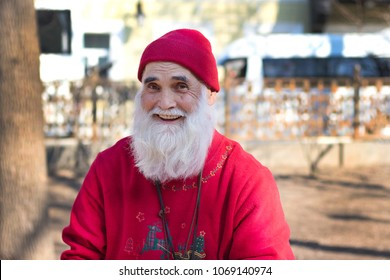 April 15, 2017. Moscow Russia. Moscow streets. Portrait of an elderly man smiling in a red hat and a red sweater.