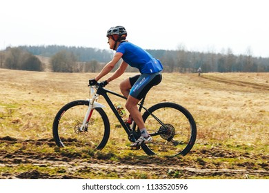 April 15, 2018, Krevo, Belarus.Beetle Trail Krevo A man is riding a bike along the trail in the field