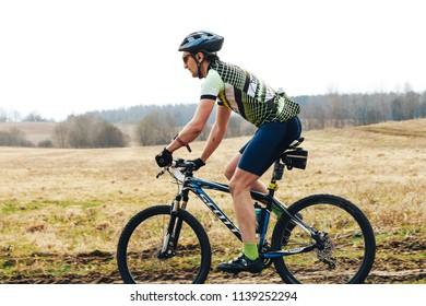April 15, 2018, Krevo, Belarus.Beetle Trail Krevo A man runs alongside a riding bicyclist