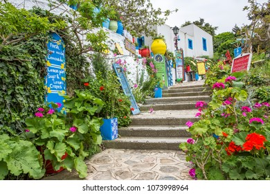 April 15th 2018 - Kos island, Greece - Street with touristic stores and taverns in the traditional Zia village, Kos island