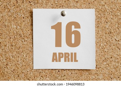 April 16. 16th day of the month, calendar date.White calendar sheet attached to brown cork board. Spring month, day of the year concept.