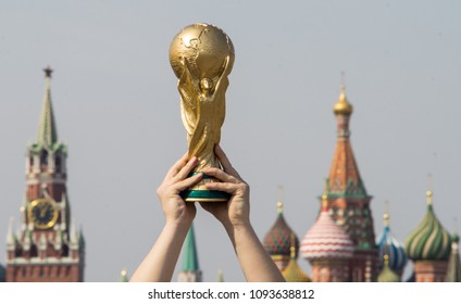 April 16, 2018 Moscow. The man holds the Trophy of the FIFA World Cup.
