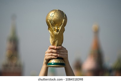 April 16, 2018 Moscow, Russia. The man holds the Trophy of the FIFA World Cup.