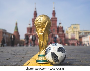 April 16, 2018 Moscow. Russia Trophy of the FIFA World Cup and official ball of FIFA World Cup 2018 Adidas Telstar 18 on the Red Square in Moscow.