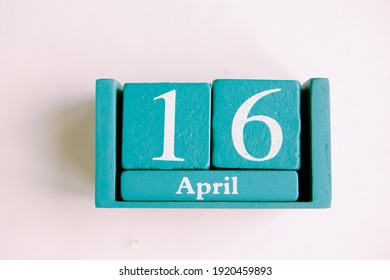 April 16. Blue cube calendar with month date isolated on white background.